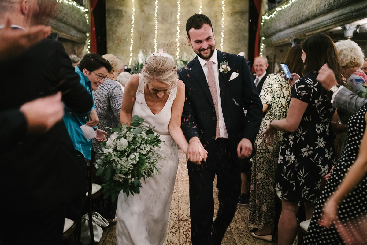 leaving the ceremony with confetti