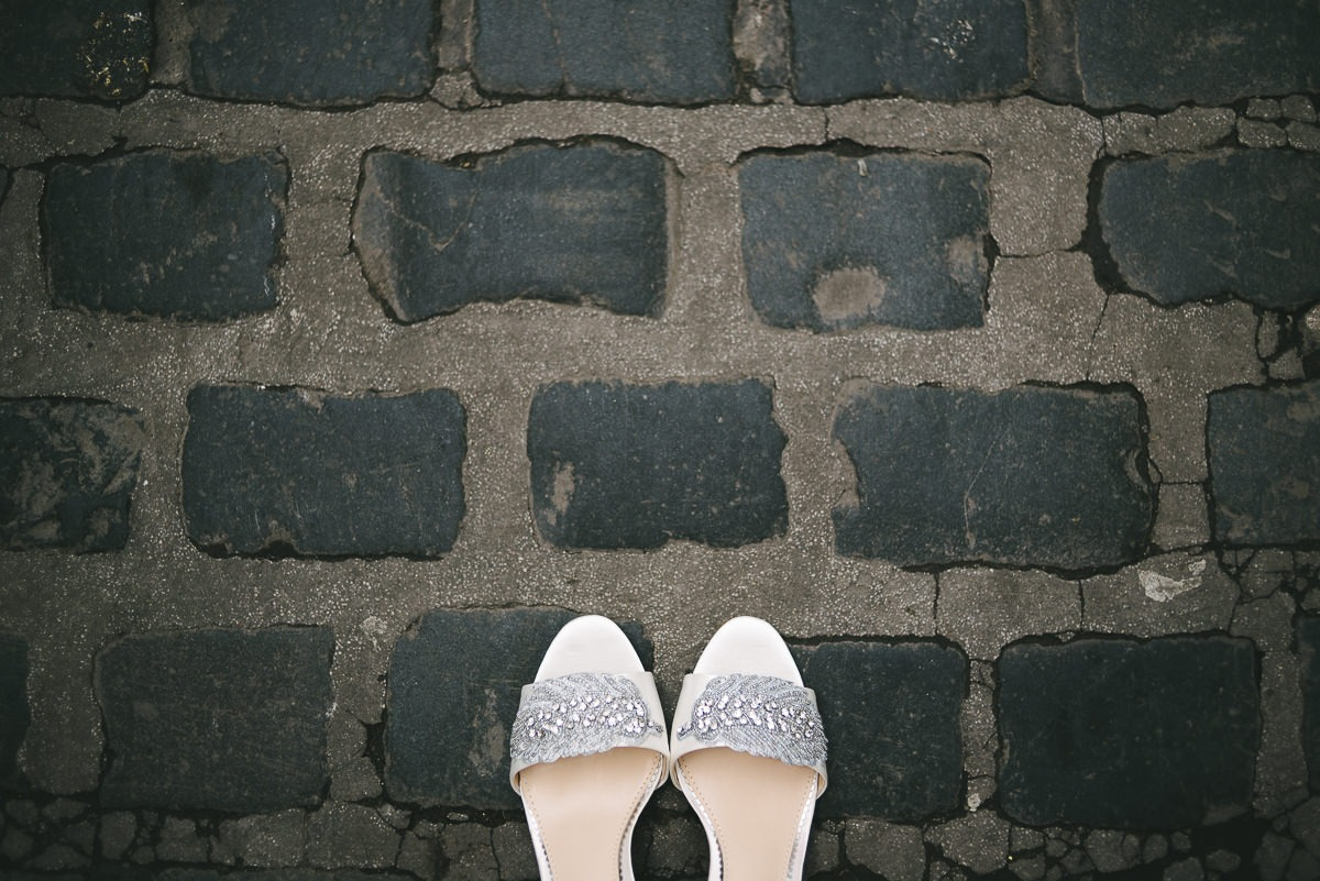 brides shoes on cobbled street